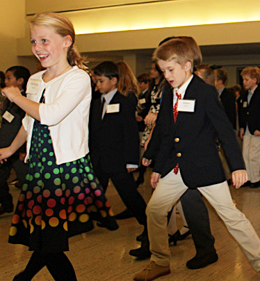 children learning to line dance